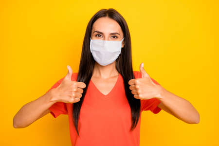 Close-up portrait of her she nice attractive healthy lady showing two double thumbup advert therapy treatment medicine mers cov flu flue grippe recovery health care isolated yellow color background