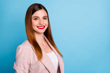 Turned photo of content pretty lovely girl executive manager look toothy smile in camera copyspace wear classy clothes isolated over blue color background 免版税图像 - 151109766
