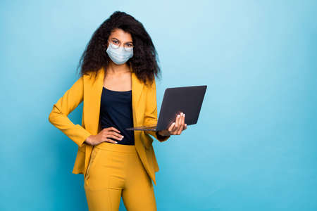 Photo of attractive chic classy lady using laptop wearing safety mask mers cov infection preventive measures working remotely from home wfh isolated blue color background