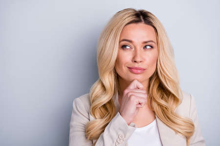 Close-up portrait of her she nice attractive charming pretty minded, smart experienced skilled wavy-haired businesslady expert director thinking isolated on light white gray pastel color background