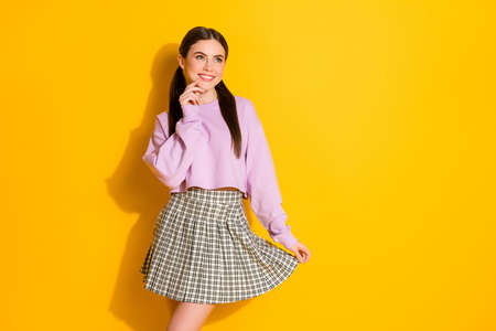 Portrait of positive interested girl look good copyspace think thoughts about her wonderful weekends wear style stylish trendy clothes isolated over bright color background