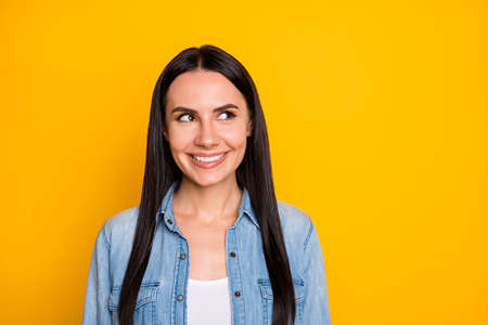 Close-up portrait of her she nice attractive lovely pretty cute smart cheerful cheery long-haired girl creating guessing new idea isolated on bright vivid shine vibrant yellow color background 写真素材