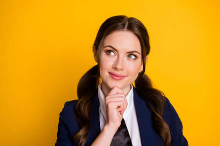 Close-up portrait of her she nice attractive pretty lovely creative cheery dreamy schoolgirl creating strategy learning memorize isolated on bright vivid shine vibrant yellow color background 写真素材