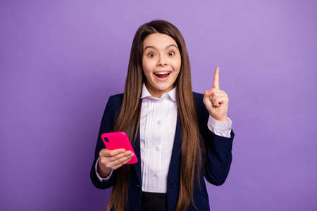 long-haired creative girl using gadget got great idea solution isolated bright vivid shine vibrant lilac violet color background