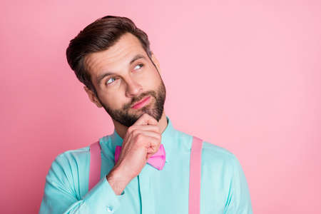 Portrait of minded guy look copyspace touch chin finger think thoughts decide choose decision choice wear formal clothes isolated over pastel color background 写真素材