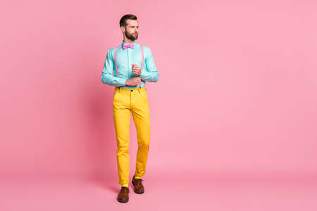 Full length body size view of his he nice attractive imposing elegant fashionable content bearded guy artist walking fixing button isolated over pink pastel color background