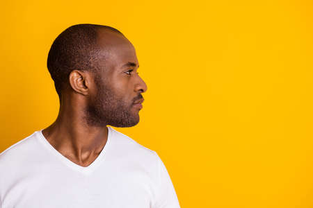 Close-up profile side view portrait of his he nice attractive calm content serious guy shaven beard groomed hairstyle isolated over bright vivid shine vibrant yellow color background