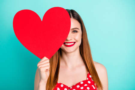 Portrait of positive cheerful girl lady close cover face big paper heart 14-february present she get boyfriend wear sundress isolated over turquoise color background