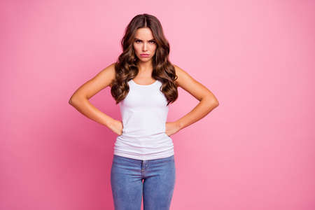 I hate you. Photo of crazy attractive lady bad mood hands by sides looking anger boyfriend late date wear white casual tank-top blue jeans isolated pink color background
