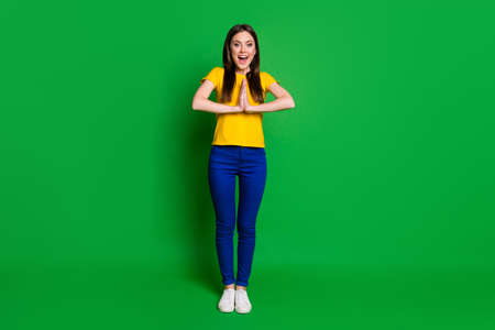 Full length body size view portrait of her she nice-looking attractive lovely cheerful cheery girl asking favor desirable gift isolated bright vivid shine vibrant green color background