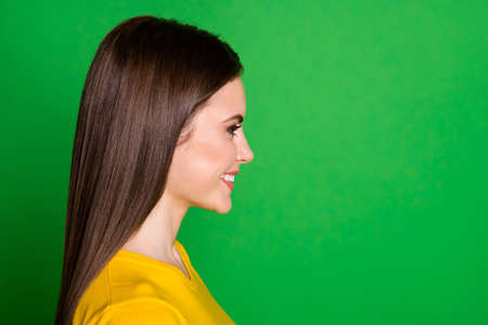 Close-up profile side view portrait of her she nice-looking attractive pretty lovely cheerful cheery straight-haired girl healthy haircare isolated on bright vivid shine vibrant green color background Banque d'images
