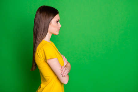 Profile side view portrait of nice-looking attractive pretty lovely charming content straight-haired girl employee folded arms isolated bright vivid shine vibrant green color background Banque d'images