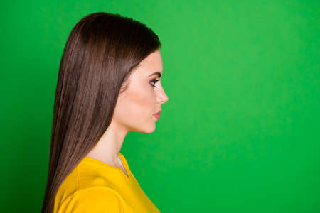 Close-up profile side view portrait of her she nice attractive pretty lovely lovable content straight-haired girl modern haircare isolated on bright vivid shine vibrant green color background