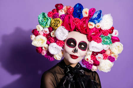 Closeup photo of charming beautiful folklore witch creature character death day facial makeup mexican event look side empty space wear floral headwear black costume isolated violet background