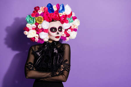 Photo of sly dark dead katrina face print folklore culture creature mexican death day holiday masquerade look side floral rosy headband black lace dress witch isolated purple color background