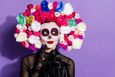 Photo of beautiful dead bride death day calaverita katrina facial tattoo zombie ornament look sly empty space floral headband black traditional costume isolated purple violet color background Stock Photo