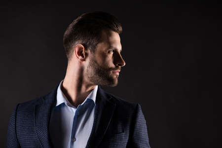 Close-up profile side view portrait of his he nice attractive successful well-groomed guy banker financier employer partner fashionable modern look isolated over dark black color background
