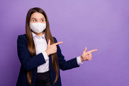 Portrait of nice small little long-haired girl wearing mask demonstrating cov mers flue influenza disease illness sickness prevention isolated bright vivid shine vibrant lilac violet color background Imagens
