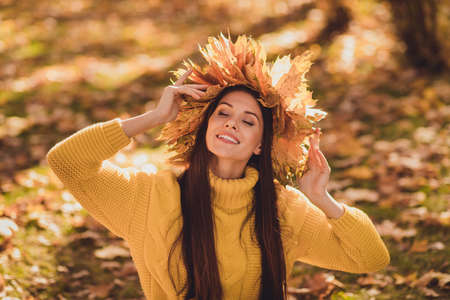 Portrait of positive cheerful girl have autumn forest woodland grove picnic enjoy sun light wear maple leaves wreath knitted sweater pullover