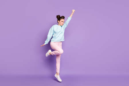 Full length body size view of nice attractive purposeful pretty slim fit serious focused girl jumping striving isolated on violet purple lilac bright vivid shine vibrant color background