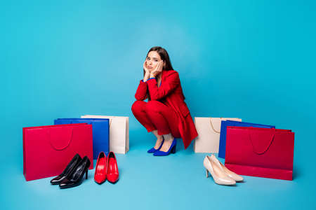 Full size photo of upset sorrow lady successful worker sitting offended near shoes shopping bags wear red suit blouse blazer pants high-heels isolated blue color background Stock fotó - 154865337