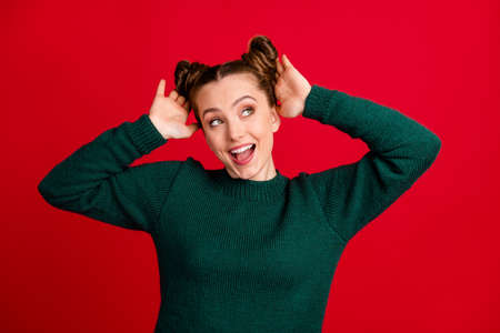 Close-up portrait of her she nice attractive pretty glad glamorous girlish cheerful cheery girl demonstrating fixing new coiffure look isolated bright vivid shine vibrant red color background