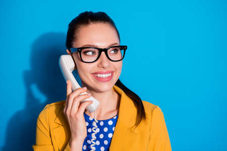 Close-up portrait of her she nice attractive charming cheerful cheery girl operator providing remote support incoming call service 24 7 isolated on bright vivid shine vibrant blue color background