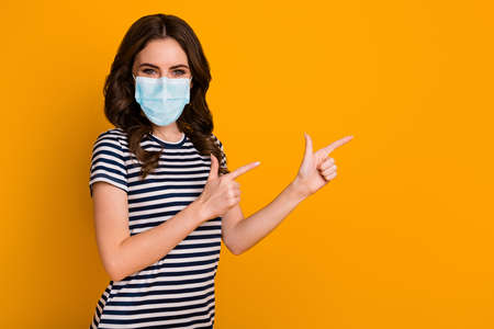 Portrait of her she attractive healthy wavy-haired girl wear safety gauze mask demonstrating advert vaccine influenza preventive measures isolated bright vivid shine vibrant yellow color background