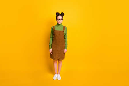 Full length photo of confident intelligent girl look good wear trendy clothes sneaker isolated over vivid color background