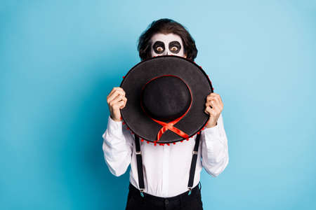 Portrait of his he classy imposing amazed stunned scared guy gentleman stranger hiding face behind sombrero spooky carnival isolated bright vivid shine vibrant blue color background Stock fotó