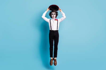 Full length body size view of his he handsome skinny tall creepy amazed stunned astonished gentleman jumping catrina celebratory having fun isolated bright vivid shine vibrant blue color background