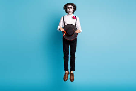 Full length body size view of his he handsome skinny tall creepy scary spooky amazed stunned gentleman jumping up catrina carnival celebratory isolated bright vivid shine vibrant blue color background