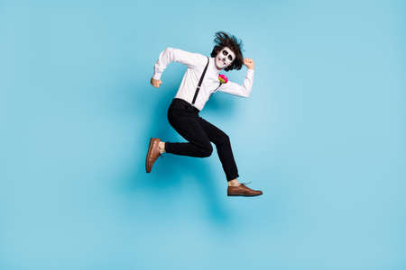 Full length body size view of his he handsome funky comic childish cheerful cheery gentleman jumping having fun running fooling calavera fest isolated bright vivid shine vibrant blue color background