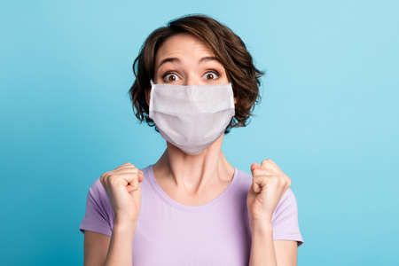Close-up portrait of her she attractive healthy amazed brown-haired girl wearing safety mask celebrating grippe recovery respiratory disease prevention isolated on blue color background