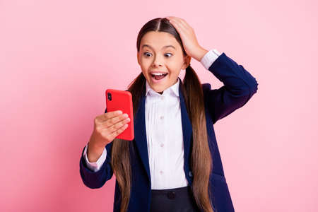 Portrait of her she nice attractive cheerful addicted small little girl using device app 5g like follow subscribe watching browsing multimedia isolated over pink pastel color background