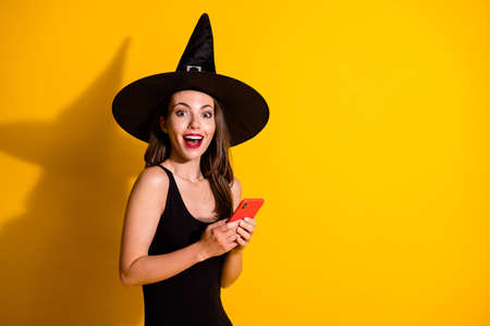 Portrait of her she nice attractive pretty amazed cheerful cheery lady wizard using device gadget app fast speed 5g like reaction copy space isolated bright vivid shine vibrant yellow color background