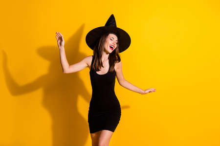 Portrait of her she nice-looking attractive pretty charming fashionable chic cheerful dreamy lady wizard dancing having fun chill isolated on bright vivid shine vibrant yellow color background