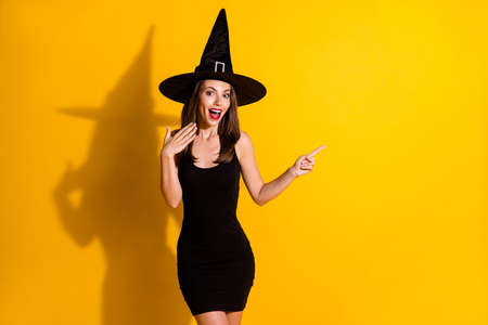 Portrait of her she nice attractive pretty glad amazed wondered cheerful lady wizard showing copy space like follow subscribe isolated over bright vivid shine vibrant yellow color background