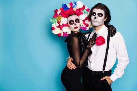 Photo of spooky tender couple man lady girl cuddle wait festival vehicle transport dead people only wear black dress death costume roses headband suspenders isolated blue color background