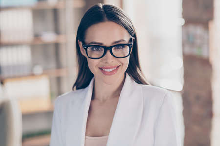 Closeup photo of attractive beautiful business lady eyesight health care concept look clever smart eyes camera toothy smiling home spacious office social distance formalwear blazer indoors