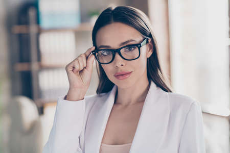 Closeup photo of attractive beautiful business lady hold touch arm hand specs eyesight care concept home spacious office social distance formal wear blazer white suit indoors Stock fotó