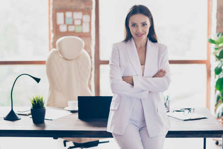 Photo of attractive beautiful business lady hold arms crossed self-confident person friendly smile home spacious office social distance formal wear blazer pants white suit indoors