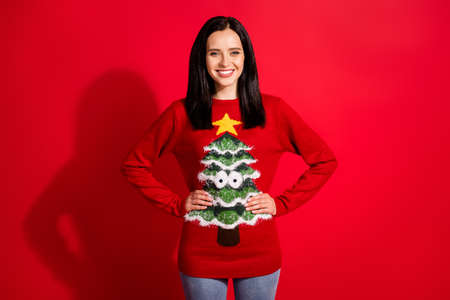 Portrait of her she nice-looking attractive pretty lovely cheerful cheery content girl hands on hips wearing ugly warm clothes isolated bright vivid shine vibrant red color background