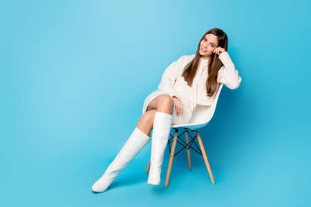 Full length photo of nice cute fancy girl sitting chair enjoy waiting job search interview wear good look trend clothes isolated over blue color background