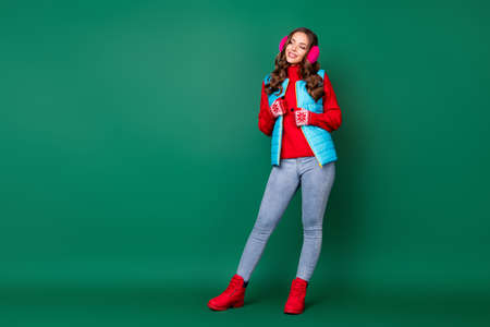 Full length body size view of nice attractive pretty lovely cheerful pensive girl wearing casual look outfit season coat warmth thinking copy space isolated over green color background