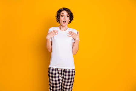 Portrait of astonished cute girl point herself hand impressed scream wow omg wear sleep outfit isolated over shine color background