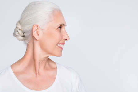 Close-up profile side view portrait of her she nice-looking attractive lovely well-groomed cheerful cheery positive glad gray-haired lady copy space isolated over light white grey pastel background