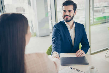 Portrait of his he her she two nice attractive stylish cheerful glad classy people guy welcoming new top manager delegation leasing shaking hands start-up project light white workplace workstation