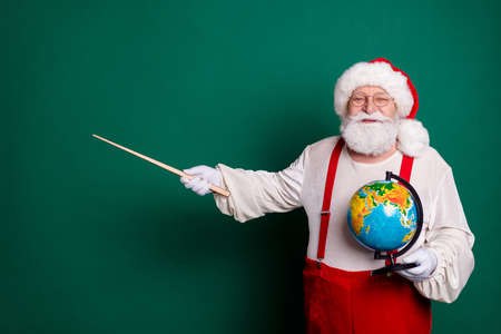 Portrait of his he nice handsome cheerful confident bearded clever smart fat Santa tutor holding in hands globe showing copy space science solution knowledge isolated green color background