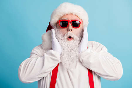 Close-up portrait of his he nice attractive amazed impressed white-haired father Santa incredible unexpected season sale isolated over bright vivid shine vibrant blue color background